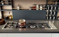 Varenna personalised flush built-in hob by Foster with four aligned burners. The collection Varenna is distinguished by the research for a total integration of surfaces, electrical appliances and functional elements