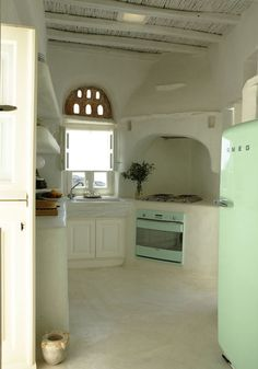 Kitchen. located in the Cyclades archipelago, on the island of Tinos. Designed by Zege Architects