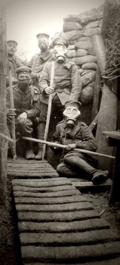 WWI, German soldiers with gasmasks in a trench. Via Picclick