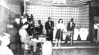 """1939-40 Miller High School Syudents:  Eli """"Lucky"""" Thompson, tenor sax; Alvin Jackson, bass; Art Mardigan, drums; Milt Jackson, vibes. Miller High School had a heavy concentration of gifted students in the late 1930s, including Art Mardigan (Mardigian)"""
