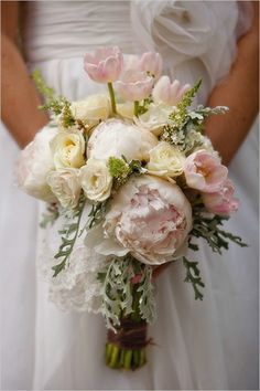 Tulips and peonies pair so well together. #wedding #bouquet (Photo by: Kathryn Krueger)
