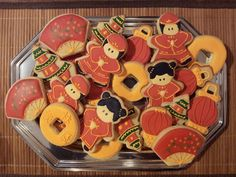 Chinese new year decorated sugar cookies. Cookie cutter hacks: fan = trimmed circle, pagoda = christmas tree, lantern = baby rattle, chinese girl = teddy bear