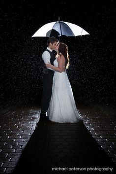 Kissing in the Rain from Michael Peterson Photography
