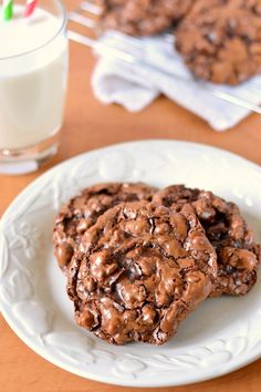 Naturally gluten, grain and dairy free rich chocolate cookies with a fudgy interior and a thin crackly top, just like a perfect brownie in cookie form! I need to start out with a warning. These a…
