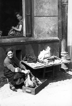 Warsaw, Poland, A woman offering various items for sale. One of the photographs taken by the German photographer Willi George over the course of a single day in the summer of 1941. The photographs are unique in that they were not staged, but showed the ghetto as it truly was.