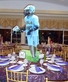 Welome to Zach's Lax Lounge created by Party Art LLC.  Live actions shots were used to create awesome Lacrosse Bar Mitzvah centerpieces.  A life size photo of the Bar Mitzvah boy in action could also be used as a sign in board!
