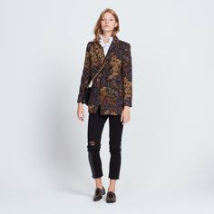 Sandro jacket<br /> • Italian collar and long sleeves<br /> • Floral print<br /> • Double-breasted button fastening <br /> • Two patch pockets<br /> • Pocket closed with a visible zip<br /> • Model is wearing a size 36<br /><br />