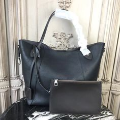 Buy LOUIS VUITTON Replica of top quality from China - Hina MM Mahina Leather is exclusively of top original order quality. Louis Vuitton Bags, White Louis Vuitton, Louis Vuitton Shoulder Bag, Lv Handbags, Luxury Handbags, Designer Handbags, Clutch Bag, Tote Bag, Calf Leather