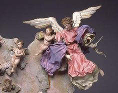 Neapolitan crèche angel with putti , AKA cherubs. Note the difference: angels are always adults, not children or babies.