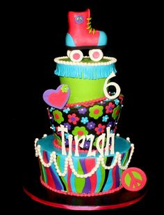 3 tier cake,covered in fondant. RKT roller skate and gumpaste accents. Loved this cake!