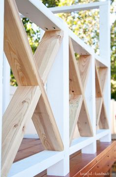 The X railing is perfect for the cottage style playhouse. See how we are building the DIY playhouse railing including build plans and time/cost breakdown. Porch Railing Designs, Front Porch Railings, Diy Exterior Railing, Deck Railing Ideas Diy, Deck Railings, Deck Building Plans, Building Steps, Diy Swing, House On Stilts