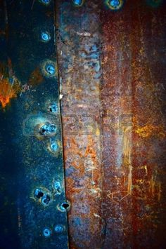 Old metal plates covered with beautiful divorces and fastened among themselves welding