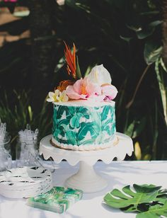Banana leaf wrapped cake, paired with hibiscus, bird of paradise, and monstera leaves!