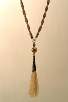 Gold twist Tassel Necklace with vintage glass pearl and beige wool tassel $38.00
