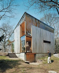 Suzanne and Brooks Kelley at the back of their 1,100-square-foot guest cottage. Architecture by Gray Organschi Architecture Location: Guilford, Connecticut