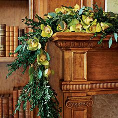 Blooming Beauty    Here, a traditional boxwood garland is dotted with citrus-green cymbidium orchids for an engaging play of color. Small water tubes within the greenery keep the blossoms fresh.