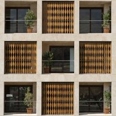Wavy+wooden+shutters+cover+gridded+apartment+block+in+Iran+by+TDC+Office