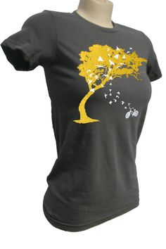 Birds on a t shirt, apparently coming out of a bicycle into a tree.