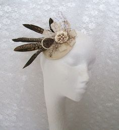 This gorgeous cream, nude & chocolate brown fascinator is a one off design, created pheasant feathers, sinamay loops, veiling choux and pearls. www.indigodaisyweddings.co.uk