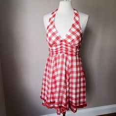 Aggie Red Checkered Halter Dress Tomato red checked halter dress with elastic smocked back. Padded bodice cups See second picture for two layer skirt with lace trim. Shown on size 6/8 mannequin (37-26-37)Check out the $6 section near the bottom of my closet (before the sold items) for lots of bundle-worthy $6 items! 15% bundle discount on 2+ items in a bundle. Aggie Dresses