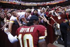 Washington Redskins quarterback Robert Griffin III walks off the field following his team's first NFL home game of the season and loss to the Cincinnati Bengals in Landover ... still a remarkable rookie QB!