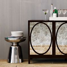 Martini Side Table - Silver | west elm - Fun small accent piece - could put two underneath a console table and pull out to use for extra surfaces when needed..