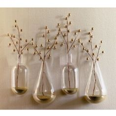 Wall mounted teardrop vases - Experiment with nature. Handblown chemistry lab borosilicate beaker glass in a simple tear shape wall-hangs via a cut and polished opening.