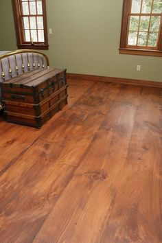 The homeowners got this look from newly sawn Eastern White Pine by using a custom mixed stain then finishing the floor with pure tung oil.