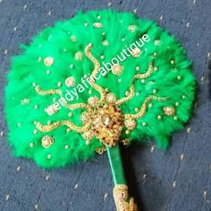 New arrival Green bead-dazzled feather hand fan. Long handle beaded and stoned. Size: Small feather in Green color Hand Fans For Wedding, Bridal Accessories, Green Colors, African Fashion, Muslim, Shower Ideas, Hair Style, Wedding Gowns, Bridal Shower