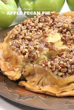 UPSIDE-DOWN APPLE PECAN PIE is a self-glazing, award-winning pie that is sure to please any crowd. Print full recipe + video at TidyMom.net