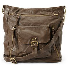 Keep everything you need with you in trendy style thanks to the T-Shirt & Jeans large brown crossbody purse. Coming in an allover dark brown PU material, this tote bag features a snap button flap pocket, three zipper pockets, a large main compartment with a magnetic closure and interior organizational pockets, and an adjustable crossbody strap so you can take all of your essentials with you in comfort and style. Go anywhere with the luxury of function and fashion with the large brown…