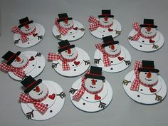 paper snowmen using tealights-make a nice place card.