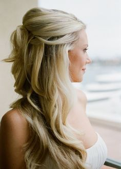 Gorgeous wavy half up hair with a bit of volume. Perfect! | http://weddingpartyapp.com/blog/2013/11/07/half-up-wedding-hair-styles-gorgeous-winter-brides/