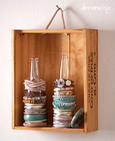 Storing bracelets on glass bottles - so doing this!