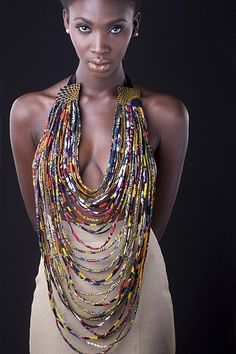 REDUCED!!! Was £95  - Long multi strand necklace - Individually hand stitched using African cotton print fabric - Statement piece - Tie fastening at back with satin ribbon  Team this fabulous necklace with jeans and t-shirt and make a bold statement.