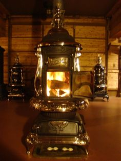 Round oak stove burning wood, just like camp! Wood Burner Fireplace, Fireplace Wall, Antique Wood Stove, How To Antique Wood, Foyers, Outdoor Wood Furnace, Outdoor Cooking Stove, Coal Stove, Cast Iron Stove