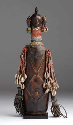 Africa | Doll from the Mandara mountain region of northern Cameroon | Wood, glass beads, cowrie shells, leather