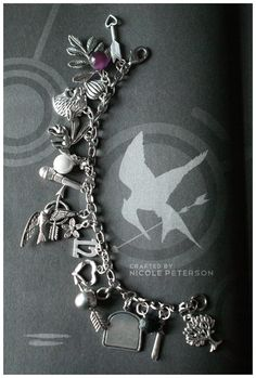 Hunger Games Charms - Not sure what some of them are, but I dig the bread one.