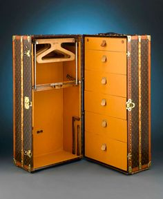 Louis Vuitton Upright Wardrobe Trunk | From a unique collection of antique and modern trunks and luggage at http://www.1stdibs.com/furniture/more-furniture-collectibles/trunks-luggage/
