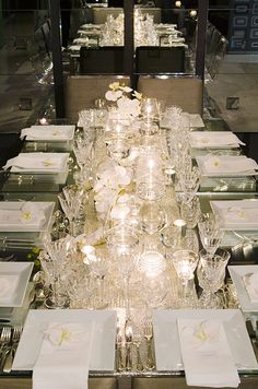 Among a bevy of crystal glasses, sporadically placed votive candles easily illuminate this table for twelve.