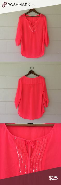 Express Hot Pink 3/4 Sleeve Blouse Express brand size small hot pink with clear sequins in a vshape near neckline ties around neckline in the middle. Bust is 41 inches length is 26 inches. 100% polyester. In excellent condition. Express Tops Blouses