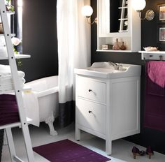 A small bathroom can still be elegant with an IKEA HEMNES sink cabinet with 2 drawers for your storage needs.