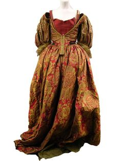 A beautiful crimson and russet gold brocade gown worn by Milla Jovocitch as Lady DeWinter in The Three Musketeers