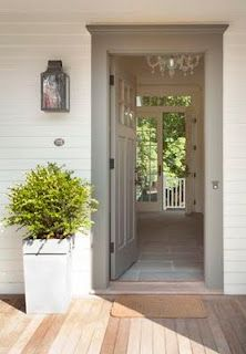 A gray front door...Love it. This would be a dream come true.
