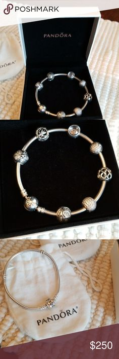Pandora bracelet with 7 Pandora charms Pandora bangle with 7 beautiful Charms and also a second braceket. 7.5 legnth Pandora Jewelry Bracelets
