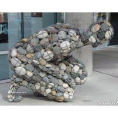 my most favorite sculpture.the weight of grief.this artist found a way to convey the physical feeling of grief. Instalation Art, Art Pierre, Rock And Pebbles, Wire Art, Pebble Art, Pebble Stone, Stone Art, Public Art, Rock Art