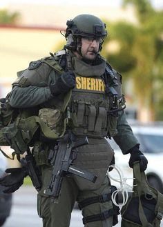 Yes I know this is law enforcement.  Pull off the sheriff panel from his plate carrier and he looks indistinguishable from military.