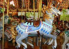 Antikes Karussell mit bunten Pferde Stockfoto