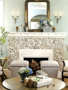 oyster shells (over the top?)  Could ask restaurant for their shells.  Doesn't look like grout; just glued on?  -Coastal Living Mag