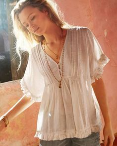 Maya top - Wrap - This kaftan-inspired linen top has pretty fringed details at the hem and sleeves. Soft empire-line styling with little gathers at the waist and fine pin-tuck details at the neck, its a relaxed and laid back piece with an easy, boxy fit. 100% Linen.